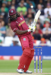 West Indies' Chris Gayle dodges a bouncer during the ICC Cricket World Cup group stage match at Trent Bridge, Nottingham.