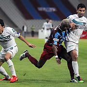 Trabzonspor's Ibrahima YATTARA (C) and Denizlispor's Ahmet B SOLAKEL (L) during their Turkish superleague soccer match Trabzonspor between Denizlispor at the Avni Aker Stadium in Trabzon Turkey on Monday, 10 May 2010. Photo by TURKPIX