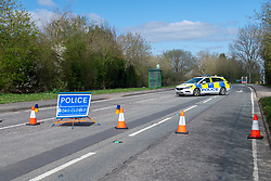 © Licensed to London News Pictures. 02/04/2021. Thatcham, UK. Police maintain a roadblock on Crookham Hill near Thornford Park Hospital after a woman, aged in her forties, was found with significant injuries in Crookham Hill, Crookham Common at approximatly 11:45pm on Thursday 01/04/2021 and died from her injuries. A man, aged 35, has been arrested on suspicion of murder. Photo credit: Peter Manning/LNP