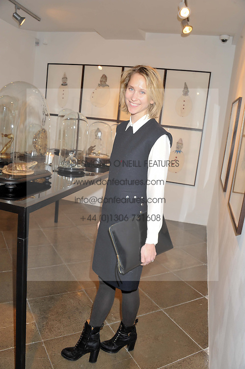 INDRE ROCKEFELLER at a private view of jewellery by Eugenie Nairchos and Noor Fares entitled Galactic Garden held at Shizaru Mayfair, 112 Mount Street, London on 5th December 2012.