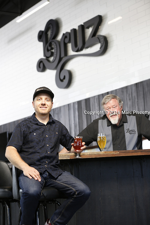 SHOT 7/22/16 1:50:07 PM - Bruz Beers co-founders Charlie Gottenkieny and Ryan Evans inside the new brewery near 67th Avenue and Pecos in Denver, Co. Bruz Beers is Denver's artisanal Belgian-style brewery, featuring a full line of traditional and Belgian-inspired brews, hand-crafted in small batches. Includes images of Evan's dog 'Cooper' as well who serves as the brewery dog. (Photo by Marc Piscotty / © 2016)