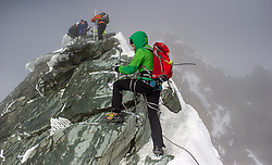 THEMENBILD - Bergsteigerin beim Sichern kurz vorm Kleinglockner. Der Großglockner ist mit 3798 m ü.A. der höchste Berg Österreichs und ein beliebtes Ziel zahlreicher Bergsteiger. Er ist in der Glocknergruppe in den Hohen Tauern. Aufgenommen am 11.10.2014 in Tirol, Österreich // Mountaineer belaying on Kleinglockner. Grossglockner is the highest mountain of austria and is located in the Hohe Tauern mountain range which is part of the central eastern alps. Tyrol, Austria on 2014/10/11. EXPA Pictures © 2014, PhotoCredit: EXPA/ Michael Gruber