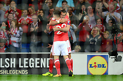 Ben Woodburn of Wales celebrates scoring a goal with Gareth Bale of Wales - Mandatory by-line: Dougie Allward/JMP - 02/09/2017 - FOOTBALL - Cardiff City Stadium - Cardiff, Wales - Wales v Austria - FIFA World Cup Qualifier 2018