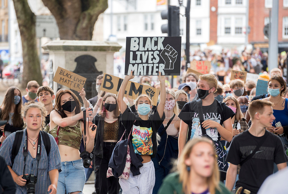 """© Licensed to London News Pictures; 16/08/2020; Bristol, UK. An All Black Lives UK rally and march takes place from College Green in front of Bristol City Hall to Castle Park, passing the empty plinth where the statue of Edward Colston was pulled down at an earlier protest in June. An All Black Lives UK protest is also taking place in London today. In Bristol in June 2020 the statue of slave trader Edward Colston was pulled down with ropes and thrown into Bristol docks on 07 June during an All Black Lives/Black Lives Matter protest that made headlines around the world. A month later in July a new sculpture titled """"A Surge of Power (Jen Reid) 2020"""" by artist Marc Quinn was put up without permission from Bristol City council. Jen Reid was at the previous protest on 07 June which was in protest for the memory of George Floyd, a black man who was killed on May 25, 2020 in Minneapolis in the US by a white police officer kneeling on his neck for nearly 9 minutes. The killing of George Floyd has seen widespread protests in the US, the UK and other countries. Photo credit: Simon Chapman/LNP."""