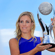 2016 U.S. Open - Day 14  US Open women's singles champion Angelique Kerber with the WTA Wold Number One trophy at the Unisphere on day fourteen of the 2016 US Open Tennis Tournament at the USTA Billie Jean King National Tennis Center on September 11, 2016 in Flushing, Queens, New York City.  (Photo by Tim Clayton/Corbis via Getty Images)