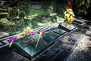 """2015/11/20- Medellín, Colombia: Pablo Escobar tomb in Montesacro Cemetery in Medellín. Pablo Escobar was killed while tempting to escape on the 2nd of December 1993, one day after he turned 44 years old.   Tours focusing on the life and death of Pablo Escobar are becoming quite popular among international tourists that visit Medellín. In recent times more than 10 tour operators have started to give the tour, helped by the interest generated by Netflix """"Narcos"""" series. (Eduardo Leal)"""