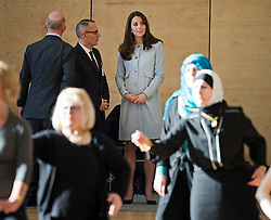 © London News Pictures. 19/01/2015. London, UK. Catherine, Duchess of Cambridge watches over a group of women practising tai chi, during a visit to formally open Kensington Leisure Centre in West London. Photo credit: Ben Cawthra/LNP