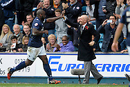 Danny Shittu of Millwall celebrates scoring his teams first goal with Millwall Manager Ian Holloway making it 1-0. Skybet football league championship match , Millwall v Cardiff city at the Den in Millwall, London on Saturday 25th October 2014.<br /> pic by John Patrick Fletcher, Andrew Orchard sports photography.