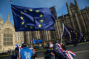 Anti Brexit and pro Europe demonstrators protest waving European Union and Union Jack flags in Westminster on 6th February 2018 in London, England, United Kingdom. As the Tories continue their negotiations with EU leaders, protesters make their views heard outside the Houses of Parliament.