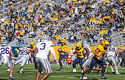 Oct 31, 2020; Morgantown, West Virginia, USA; West Virginia Mountaineers quarterback Jarret Doege (2) drops back to pass during the second quarter against the Kansas State Wildcats at Mountaineer Field at Milan Puskar Stadium. Mandatory Credit: Ben Queen-USA TODAY Sports