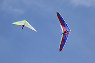 Ellenville, NY - Two hang gliders soar in the sky on Oct. 25, 2009.