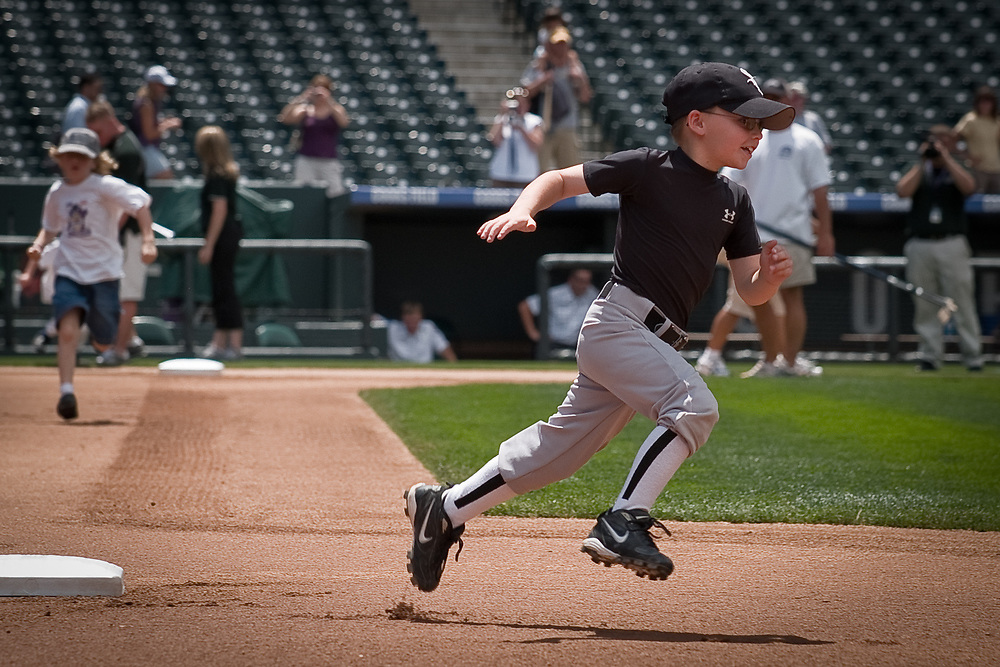 Eight year-old JAYDEN SMITH rounds second base.