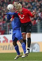 v.l. Gerald Asamoah, Jonas Troest Hannover <br /> Bundesliga Hannover 96 - FC Schalke 04<br /> Norway only