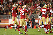 San Francisco 49ers free safety Eric Reid (35) high fives outside linebacker Eli Harold (58) after making a play against the Los Angeles Rams at Levi's Stadium in Santa Clara, Calif., on September 12, 2016. (Stan Olszewski/Special to S.F. Examiner)