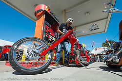 Filling up on Main Street during Daytona Beach Bike Week, FL., USA. March 9, 2014.  Photography ©2014 Michael Lichter.