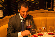 New York, NY, Sept. 30, 2013. Grant Reynolds, wine director at Charlie Bird. Diner Michael Liou samples a Barolo.