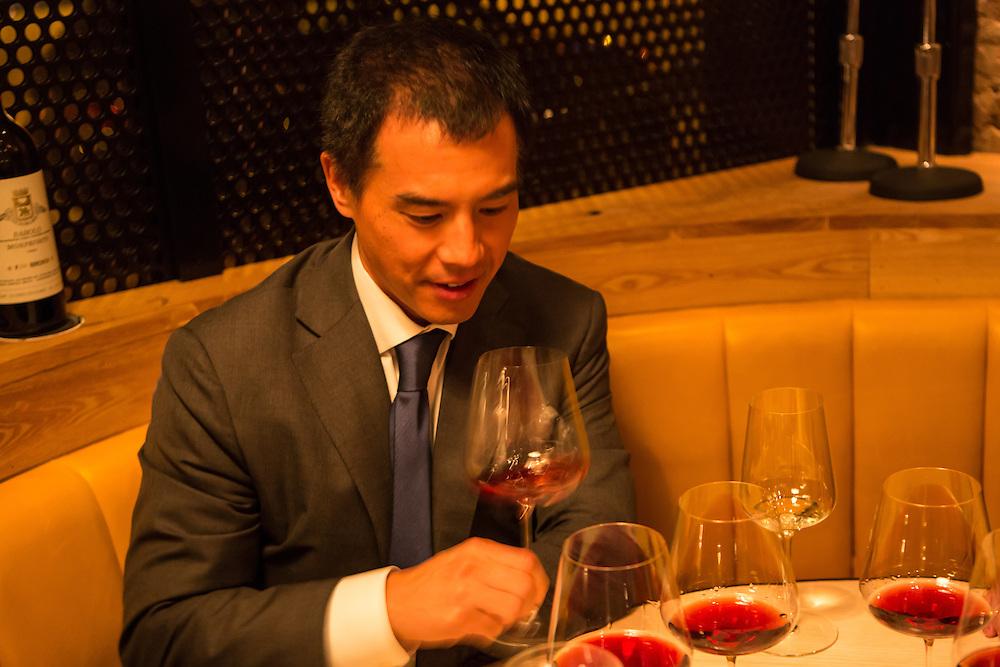 New York, NY, Sept. 30, 2013. Grant Reynolds, wine director at Charlie Bird. Diner Michael Liou samples a Barolo.