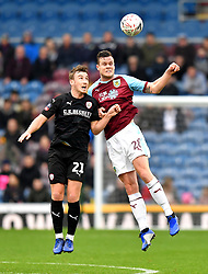 Barnsley's Mike-Steven Bahre (left) and Burnley's Kevin Long (right) battle for the ball during the Emirates FA Cup, third round match at Turf Moor, Burnley.