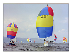 The Clyde Cruising Club's 1977 Tomatin Trophy the first Scottish Series held at Tarbert Loch Fyne.  An overnight race from Gourock to Campbeltown then on to Olympic Triangles in Loch Fyne. ..888C Hilvador of Largs heading downwind with the fleet.