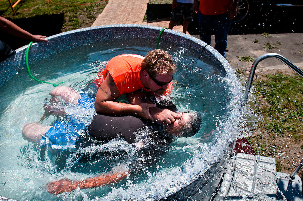 Matt Dixon   The Flint Journal..Steve DeSmyter, 59, of Bay City is baptized by Frank Katulski at the 15th annual biker day hosted by Hogs In Ministry at the River Church in Holly Sunday.  Katulski, who has been with the ministry for six years has been baptizing for the past three. The event celebrates bikers and others who have turned their lives around through God.