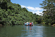 South Pacific, The Republic of Vanuatu, Shefa Provence, Epule River Valley tourists in a Dugout canoe