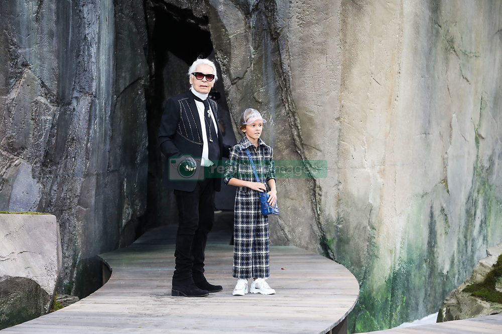 File photo - Designer Karl Lagerfeld and Hudson Kroenig walk the runway during the Chanel show as part of the Paris Fashion Week Womenswear Spring/Summer 2018 on October 3, 2017 in Paris, France. Karl Lagerfeld died on Monday at age 85. One who may inherit is his godson Hudson. Hudson's dad, model Brad Kroenig, is like 'family' to Lagerfeld. Hudson began modeling for Chanel at age two and had continued to pop up on the runway ever since. Photo by Alain Gil-Gonzalez/ABACAPRESS.COM
