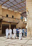 Young men chatting after prayer in the mosque, in the narrow streets of the medina in Fes,Morocco