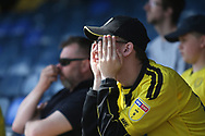 A Brewers fan can hardly bear to watch during the EFL Sky Bet League 1 match between Southend United and Burton Albion at Roots Hall, Southend, England on 22 April 2019.