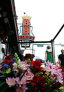 Fans paid their respects to B.B.KING outside of his Memphis Blues Club by laying flowers on the musical note dedicated to him on Beale Street in Memphis, Tennessee on Saturday. They are also signing a giant banner nearby. B.B. was a nick name given to him on Beale Street.  His nick name was Beale Street Blues Boy. The Mississippi-born legend died in his sleep at 11:40 p.m on Thursday night. King made a name for himself as a young man, as a blues artist on Beale Street in Memphis, where he later opened a name sake club.