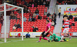 Aaron Williams of Peterborough United scores the equalising goal - Mandatory byline: Joe Dent/JMP - 19/03/2016 - FOOTBALL - The Keepmoat Stadium - Doncaster, England - Doncaster Rovers v Peterborough United - Sky Bet League One