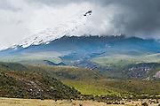 Cotopaxi is a stratovolcano in the Andes Mountains, located about 75 kilometers (50 miles) south of Quito, Ecuador, South America. It is the second highest summit in Ecuador, reaching a height of 5,897 m (19,347 ft). Cotopaxi has an almost symmetrical cone that rises from a highland plain of about 3,800 metres (12,500 ft), with a width at its base of about 23 kilometers (14 mi). It has one of the few equatorial glaciers in the world, which starts at the height of 5,000 meters (16,400 feet). The mountain is clearly visible on the skyline from Quito. It is part of the chain of volcanoes around the Pacific plate known as the Pacific Ring of Fire. Cotopaxi National Park (Spanish: Parque Nacional Cotopaxi) is a protected area in Ecuador in the Cotopaxi Province, Napo Province and Pichincha Province.