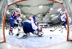 RODMAN Marcel of Slovenia and SUNG JE PARK goalkeeper of Korea at Round 4 of IIHF Ice-hockey World Championships Division I Group B match between National teams of Slovenia and South Korea, on April 21, 2010, in Tivoli hall, Ljubljana, Slovenia.  (Photo by Vid Ponikvar / Sportida)