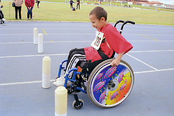 Young wheelchair user taking part in Mini games sports event held at Stoke Mandeville Stadium,