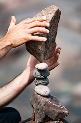 Dunbar, Scotland, UK. 20 April, 2019.Detail of stone stack being erected on Eye Cave beach in Dunbar during opening day of the European Stone Stacking Championship 2019.