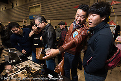Checking out Jeff Decker's wares at the annual Mooneyes Yokohama Hot Rod and Custom Show. Japan. Sunday, December 7, 2014. Photograph ©2014 Michael Lichter.