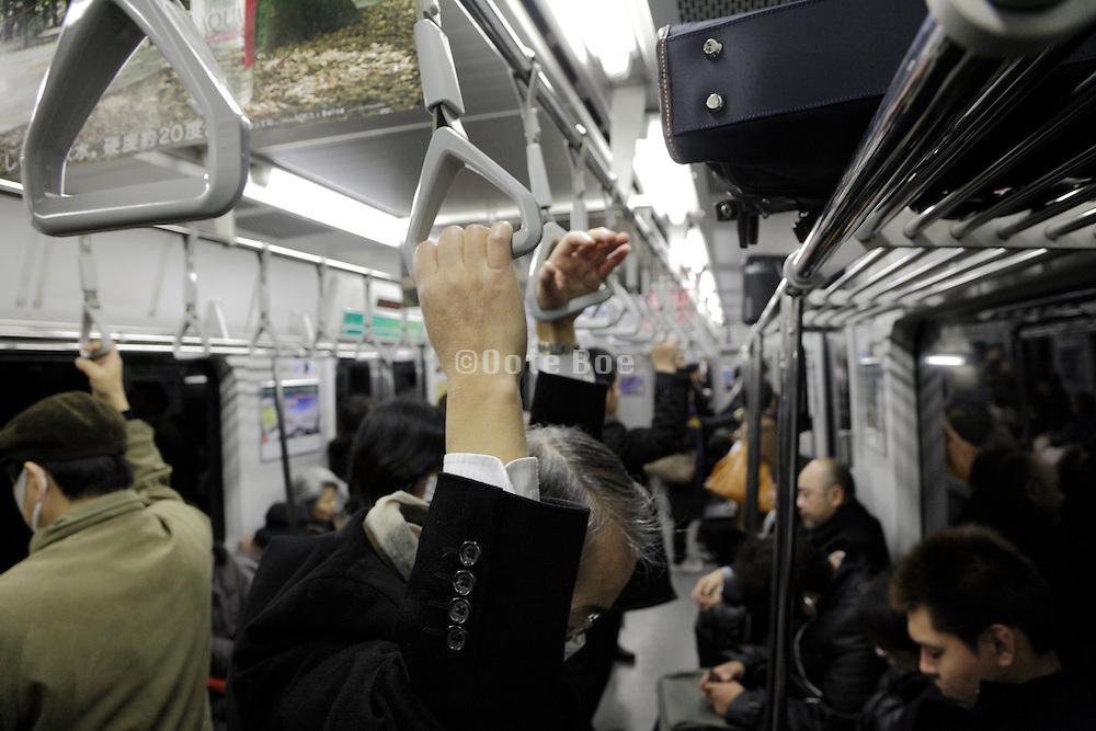 tired senior businessman in Japanese commuter train