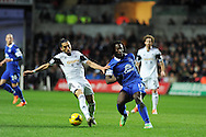 Romelu Lukaku of Everton ® is challenged by Swansea city's Chico Flores. Barclays Premier league, Swansea city v Everton at the Liberty Stadium in Swansea,  South Wales on Sunday 22nd Dec 2013. pic by Andrew Orchard, Andrew Orchard sports photography.