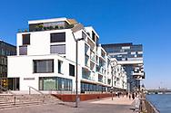 the residential building Wohnwerft by the architects Oxen und Roemer at the Rheinauhafen, in the background the Crane Houses, Cologne, Germany.<br /> <br /> Europa, Deutschland, Koeln, das Wohngebaeude Wohnwerft der Architekten Oxen und Roemer im Rheinauhafen, im Hintergrund die Kranhaeuse, Koeln, Deutschland.