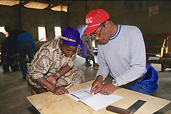 Kenyan Woman & Bob Building Solar Oven