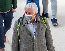 © Licensed to London News Pictures. 16/03/2020. London, UK. A man in a mask at a quiet Victoria Station this morning as Government ministers warn that over 70s will face self-isolation for weeks as the Coronavirus disease pandemic continues . Photo credit: Alex Lentati/LNP