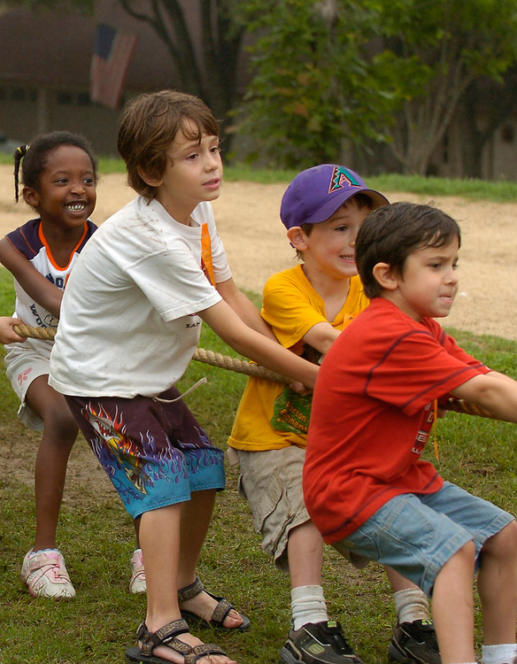 """Austin, Texas: Second grade boys and girls participate in Barton Hills Elementary outdoor """"Olympics"""" playday tug-of-war, May 2007   ©Bob Daemmrich"""