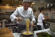 Still image from the Pastificio di Martino Pasta chef competition in New York, Primo di Manhattan. Italian Chef Massimo Sola of Mamo preparing his dish and Patrizia Volanti next up