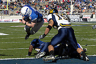 December 31, 2007 - Fort Worth, TX...Quarterback Shaun Carney #5 of the Air Force Falcons dives across the goal line in front of linebacker Anthony Felder #15 of the California Golden Bears, to give Air Force a 7-0 lead during the Bell Helicopter Armed Forces Bowl at Amon G. Carter Stadium in Fort Worth, Texas on December 31, 2007...Peter G. Aiken/CSM