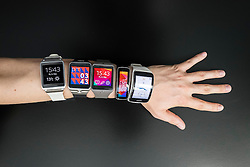 Many Samsung Gear smart watches displayed on an arm at IFA 2014 consumer electronics show in Berlin