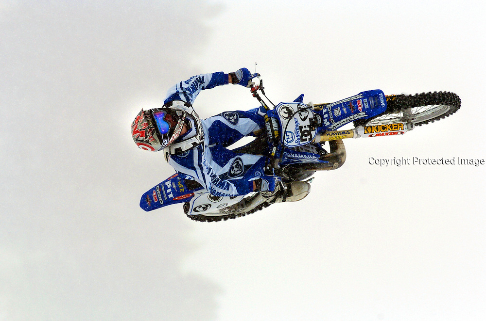SHOT 1/25/2004 - Moto X competitor Nate Adams of Wittman, Az. throws a backflip off the 90 foot jump during Moto X Best Trick practice at Winter X Games VIII at Buttermilk Mountain in Aspen on Sunday. The finals of the event were postponed until Monday morning because of weather conditions. The five day long event that started Friday and continues through Tuesday and features more than 250 of the top winter sports athletes from across the globe competing in Moto X, Ski, Snowboard and Snowmobile. For the first time, the Winter X Games will feature first-time nighttime events to go along with the live telecasts. Events are free to attend..(Photo by Marc Piscotty / 2004)