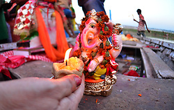 September 4, 2017 - Allahabad, Uttar Pradesh, India - Allahabad: A devotee offer prayer to Elephant headed Hindu God Ganesha before immersing idol in a pond on the ocassion of Anant Chaturdasi festival celebration in Allahabad on 09-04-2017. (Credit Image: © Prabhat Kumar Verma via ZUMA Wire)