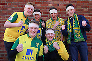 a Group of Norwich City fans with bandages pose and chant outside Selhurst Park before k/o. Barclays Premier League match, Crystal Palace v Norwich city at Selhurst Park in London on Saturday 9th April 2016. pic by John Patrick Fletcher, Andrew Orchard sports photography.