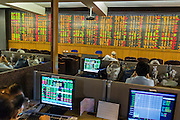 02 SEPTEMBER 2013 - BANGKOK, THAILAND:  People watch real time changes in the Thai stock market on the stock ticker at Asia Plus Securities headquarters in central Bangkok. The Thai stock market has declined more than 20% from its 2013 high as data as Thailand entered a recession in the second quarter. The loss of value in the Stock Exchange of Thailand (SET) is the greatest sell off since the end of the Asian financial crisis in 1998. Foreign investors have sold more than $1 billion of local shares this month amid signs of slowing regional economic growth and speculation that the U.S. Federal Reserve will soon cut its stimulus.     PHOTO BY JACK KURTZ