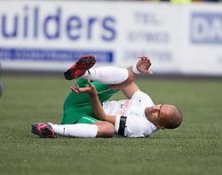 Hibernian's Farid El Alagui injured.<br /> half time : Alloa Athletic 0 v 1 Hibernian, Scottish Championship game played 30/8/2014 at Alloa Athletic's home ground, Recreation Park, Alloa.