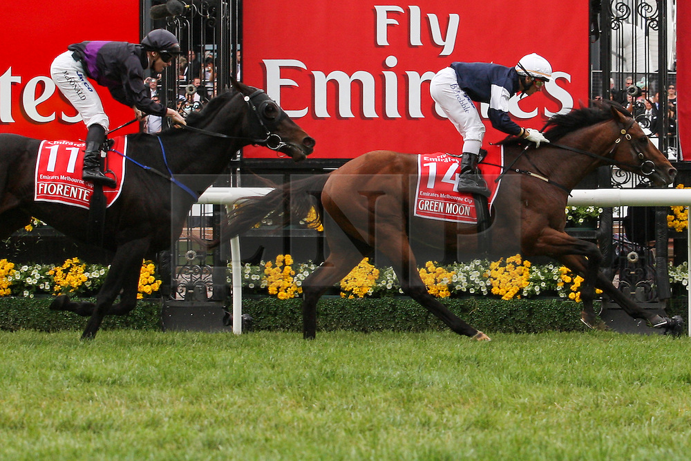 © Licensed to London News Pictures. 06/11/2012. Green Moon ridden by jockey Brett Pebble heads over the line followed by Fiorente during the Emirates Melbourne Cup at the Flemington Racecourse, Melbourne. Photo credit : Asanka Brendon Ratnayake/LNP